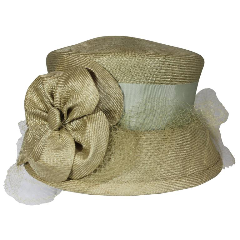 Suzanne Couture Millinery Light Olive Straw Hat with Ribbon, Flower, and Net For Sale
