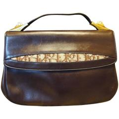 Vintage Christian Dior dark brown leather handbag with partial trotter jacquard.