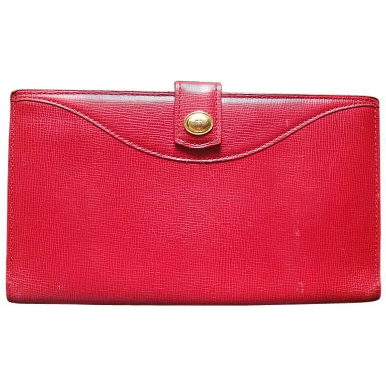Vintage Christian Dior red genuine leather wallet with gold tone CD charm.