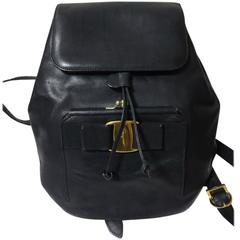 Vintage Salvatore Ferragamo black calf leather backpack from vara collection.