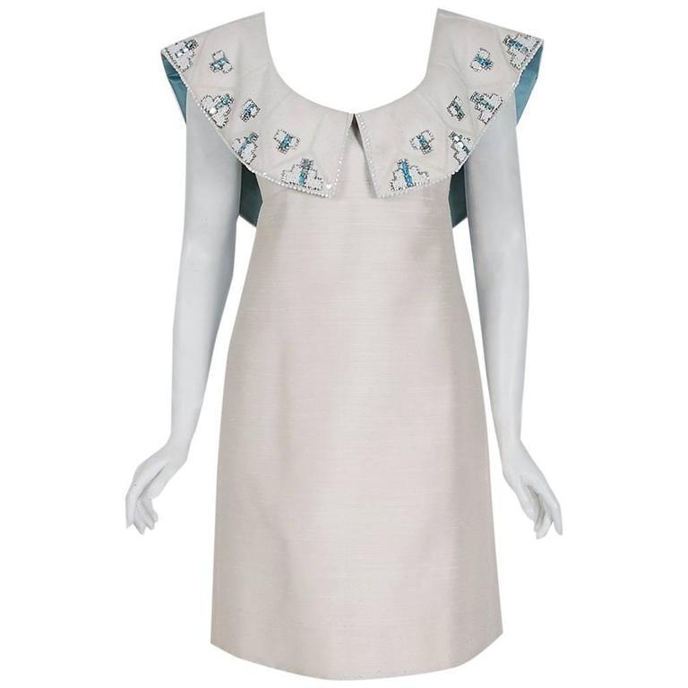1960's Mr. Blackwell Ivory-Silk Beaded Rhinestone Shawl-Collar Mod Party Dress For Sale