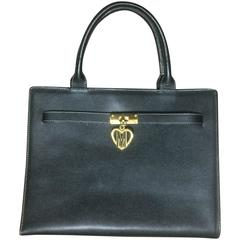 Vintage MOSCHINO black leather tote bag in Kelly purse style with iconic M charm