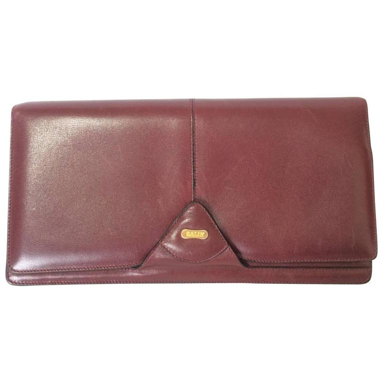 Vintage Bally wine leather clutch bag, party and classic purse with golden logo.