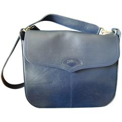 Vintage Longchamp navy leather shoulder bag with the embossed logo at front flap