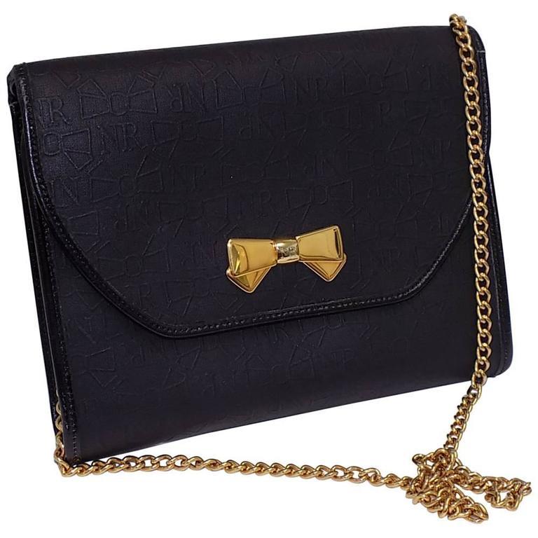 Nina Ricci black coated canvaswith gold chain bag / clutch
