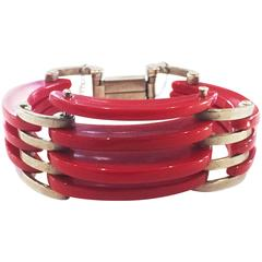 Rare red bakelite and chrome bangle attributed to Jacob Bengel