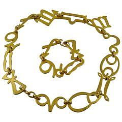 Kenzo Vintage Gold Tone Zodiac Necklace and Bracelet Set