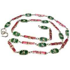 Vintage Roberta di Camerino red orange and green charm golden necklace and belt.