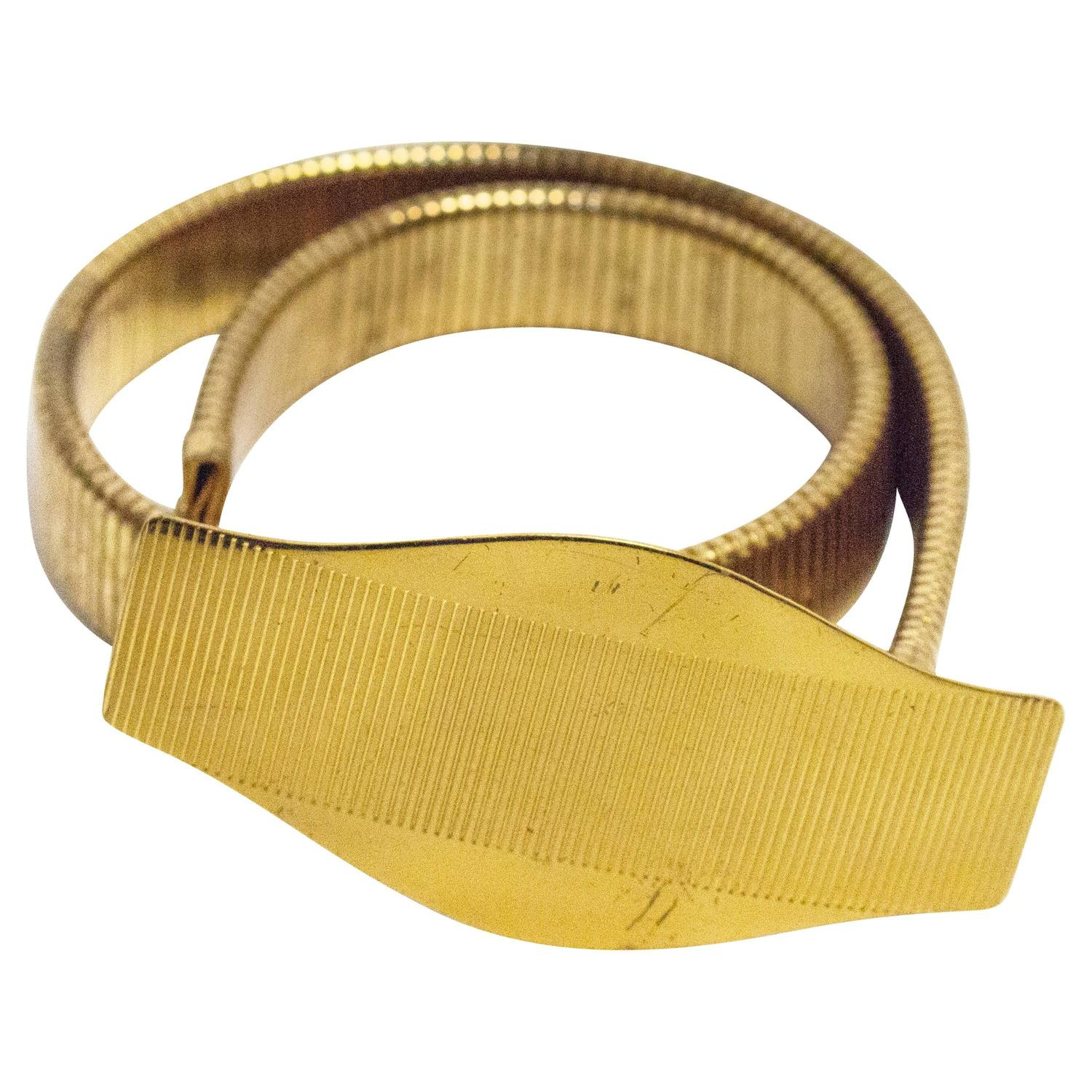 70s wide gold stretch belt for sale at 1stdibs