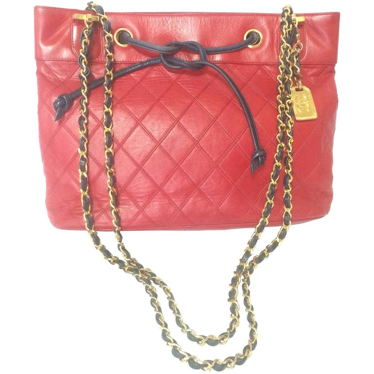 Vintage CHANEL classic tote bag in red leather with golden chain and navy straps