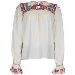 Folk blouse with floral pattern