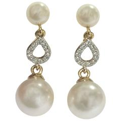 Vintage Nina Ricci white faux pearl and crystal stone teardrop dangling earrings