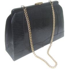 Sleek Ebony Lizard Skin Structured Handbag c 1960