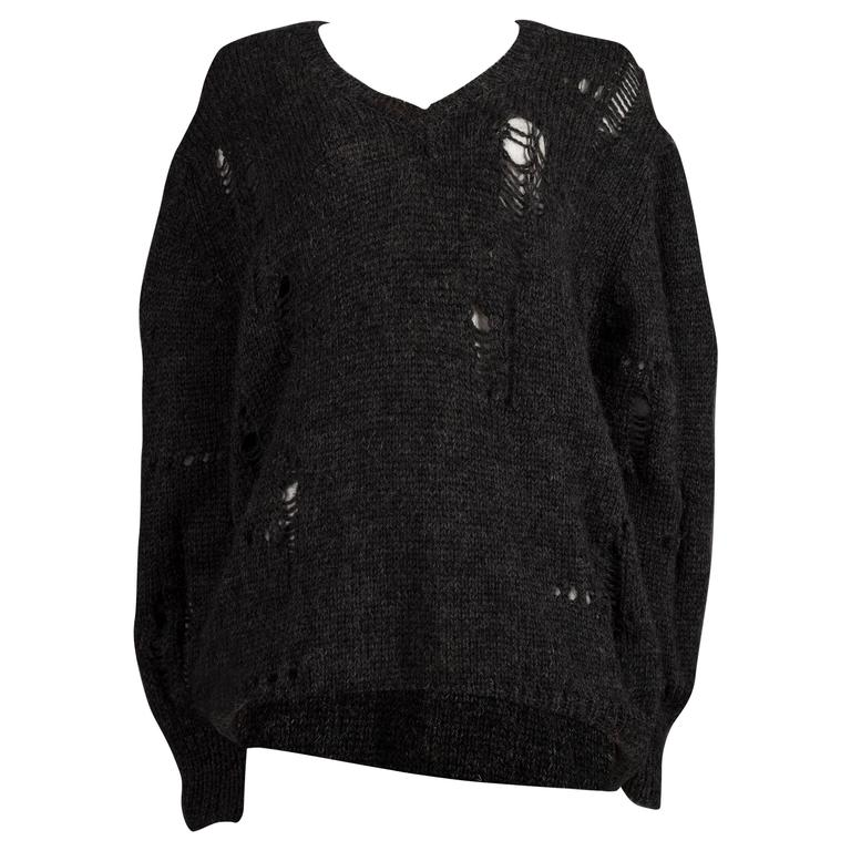 Comme des Garcons oversized sweater decorated with holes, circa ...