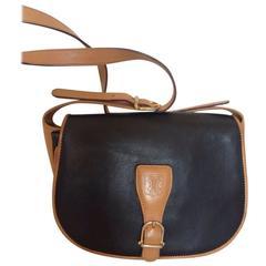 Vintage Celine black and brown genuine leather shoulder bag with logo embossed.