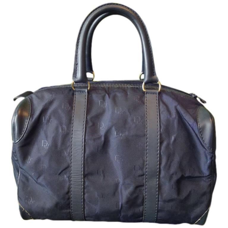 Vintage Christian Dior navy bag in nylon logo jacquard and leather handles.