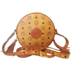 Vintage MCM rare brown monogram round shoulder bag with brown leather trimmings.