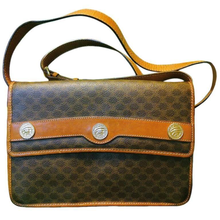 Vintage Celine iconic macadam blaison pattern shoulder bag with golden motifs.