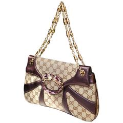2000s Gucci Dragon Monogram Canvas and Purple Leather Handbag by Tom Ford