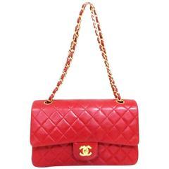 Vintage CHANEL red lambskin classic 2.55 double flap golden chain shoulder bag.