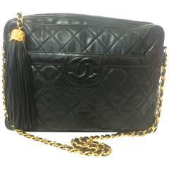 Vintage Chanel black large camera bag style chain shoulder bag with a CC fringe