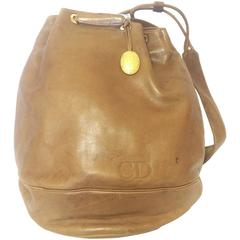 Vintage Christian Dior brown nappa leather backpack design, large hobo bag.