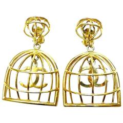 Vintage CHANEL gold tone bird cage design dangle earrings with CC mark.Rare