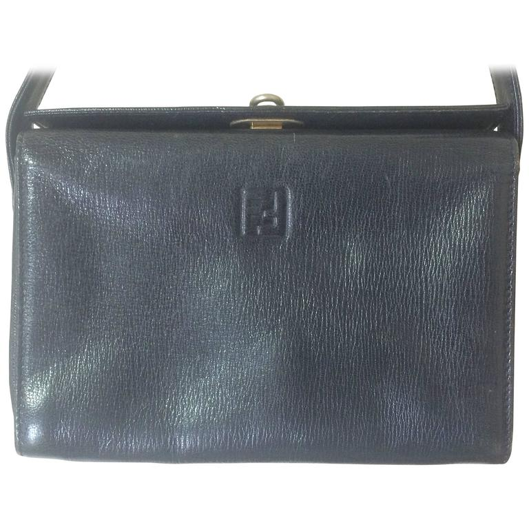 Vintage FENDI genuine navy leather square and triangle shape handbag with logo