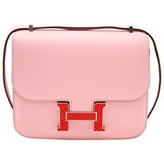 Very Rare and New Hermès Constance 18cm Rose Sakura lezard / tadelakt