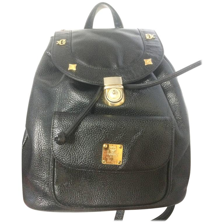 Vintage MCM genuine leather black backpack with logo motifs, By Michael Cromer. For Sale