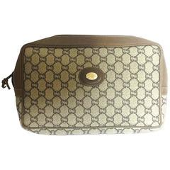 80's vintage Gucci Plus beige monogram clutch bag, cosmetic, toiletry pouch.