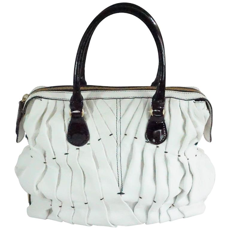 Valentino Garavani White Pebbled Leather Handbag W Black Patent Handles Ghw For