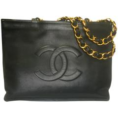 Vintage CHANEL black calfskin large tote bag with gold tone chain handles and CC
