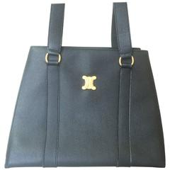 Vintage CELINE black trapezoidal tote with red lining and gold tone Celine logo
