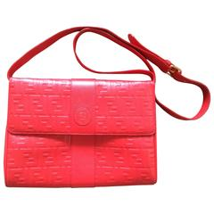 MINT. Vintage FENDI red genuine leather shoulder bag with FF embossed logo.