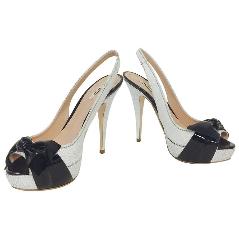 8a93cd95796 Miu Miu White Cracked Leather Platform Slingbacks With Black Patent Leather  Bows For Sale
