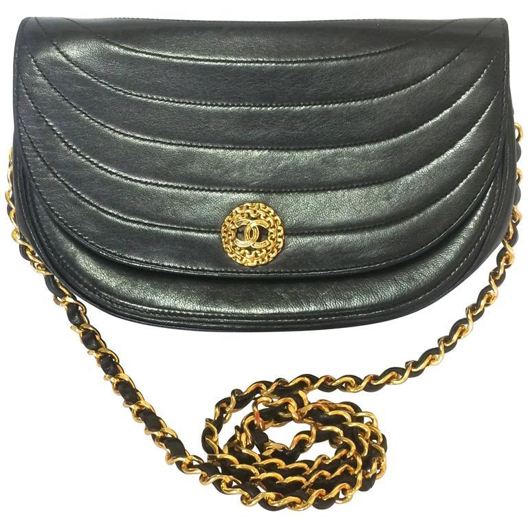 Vintage Chanel black lambskin half moon 2.55 chain shoulder bag with golden CC. For Sale