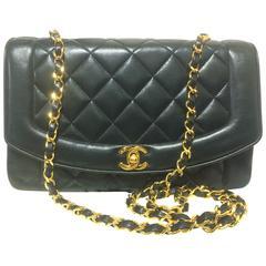 MINT. Vintage CHANEL black lambskin classic flap 2.55 gold chain shoulder bag.