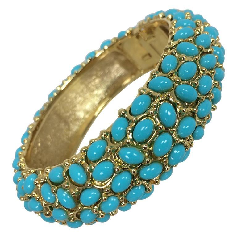 Kenneth Lane turquoise cabochon encrusted gold clamper bracelet 1