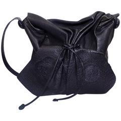 Carlos Falchi's signature black cross-body drawstring large bag