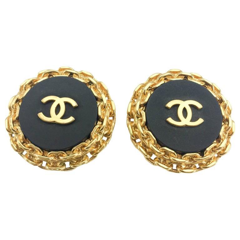 chanel gold plate on black resin large logo earrings