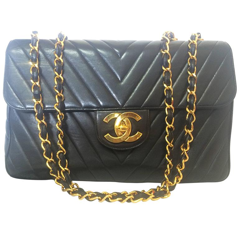 Vintage CHANEL classic jumbo, large 2.55 black shoulder bag with chevron stitch 1