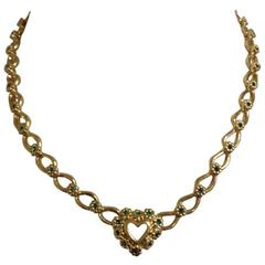 MINT. Vintage NINA RICCI necklace with heart and flower motifs, green crystals