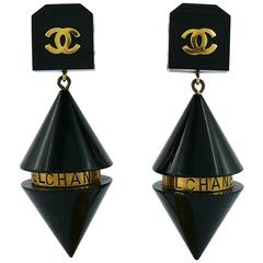 Chanel Vintage Rare Cylindrical Black Lucite and Logo Dangling Earrings