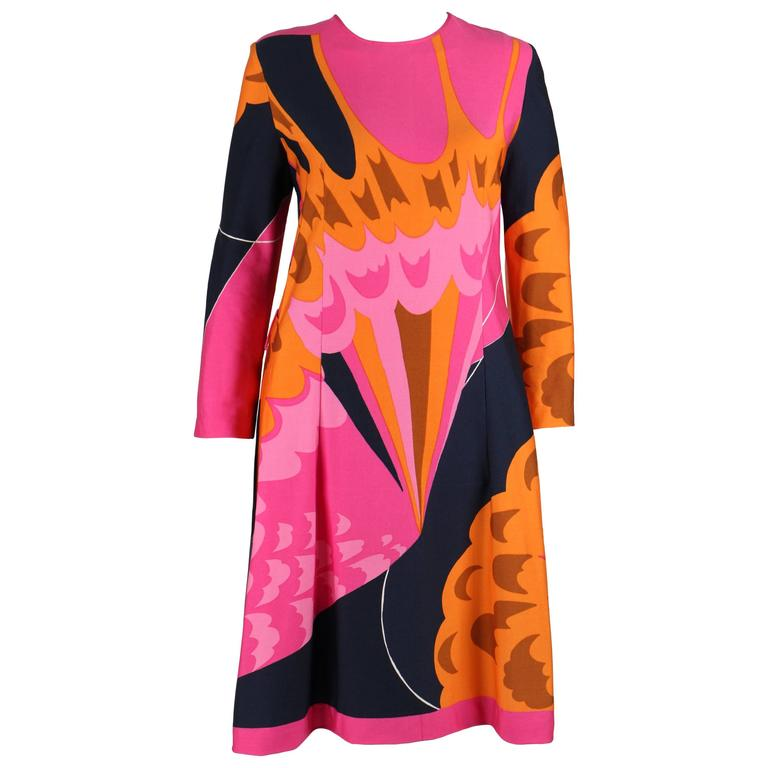 Vintage c.1970s Hanae Mori pink, orange, and navy multicolor abstract print shift dress. Long sleeve. Round neckline. Above the knee length. Two belt loops.  No Belt. Center back zipper closure. Unmarked Fabric Content: Poly-blend. Unmarked size: