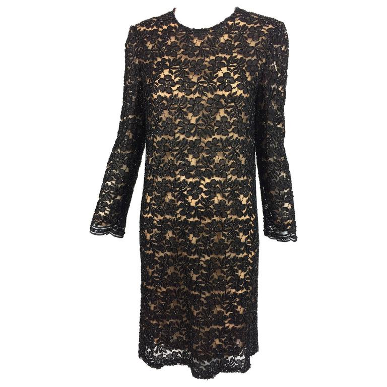 Vintage mod style beaded black floral lace nude lined cocktail dress 1960s For Sale