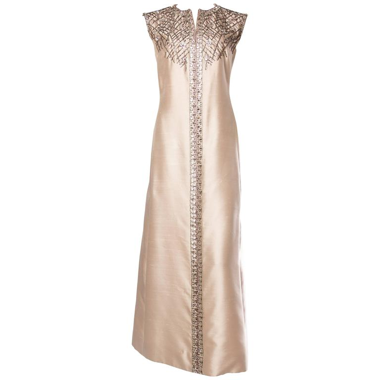 Strikingly Modern Oyster Pink Gown Heavily Embelished with Crystals