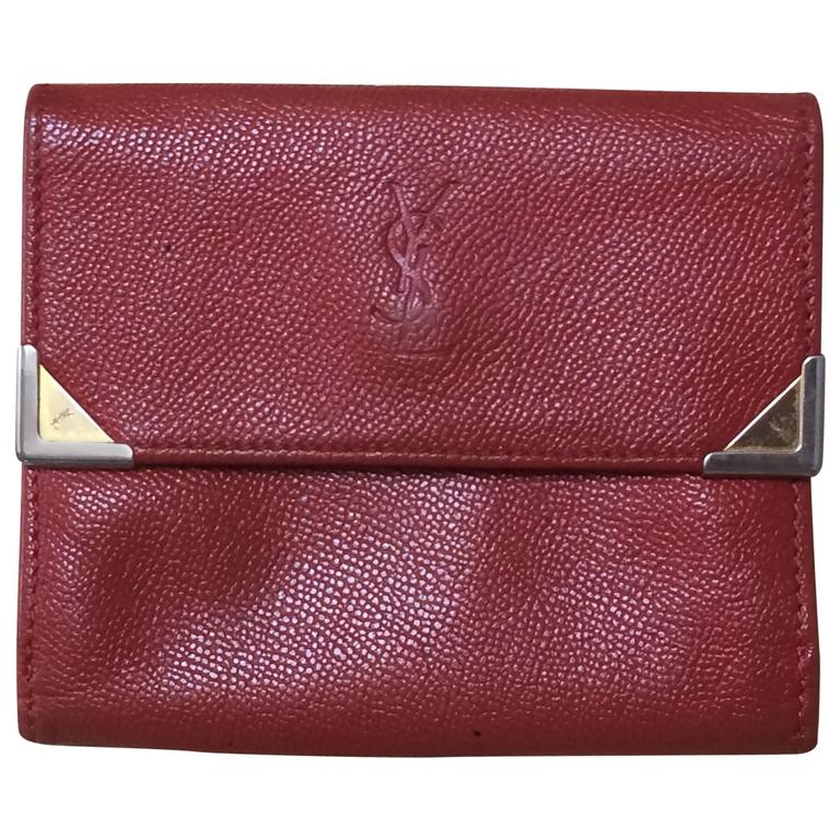 Vintage Yves Saint Laurent red leather wallet with YSL logo embossed motif