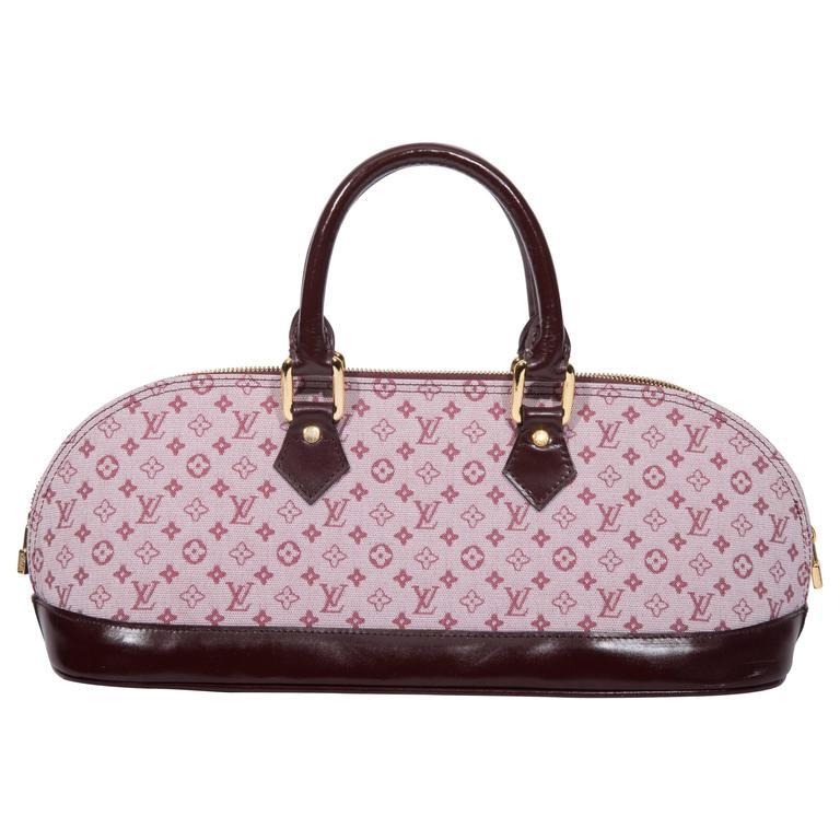 louis vuitton mini lin long top handle handbag at 1stdibs