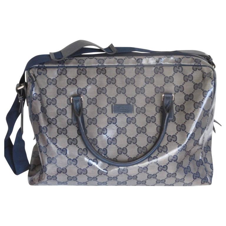 fede5f7e253 gucci coated monogram blue travel bag For Sale at 1stdibs